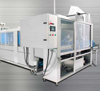 Fully automatic system to process multiple-sized bottles.